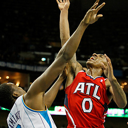 January 29, 2012; New Orleans, LA, USA; Atlanta Hawks point guard Jeff Teague (0) shoots over New Orleans Hornets small forward Al-Farouq Aminu (0) during the second half of a game at the New Orleans Arena. The Hawks defeated the Hornets 94-72.  Mandatory Credit: Derick E. Hingle-US PRESSWIRE