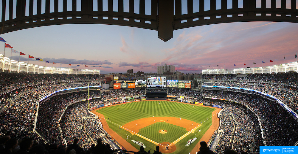 A panoramic view of Yankee Stadium as the sun sets during the New York Yankees V Baltimore Orioles American League Division Series play-off decider at Yankee Stadium, The Bronx, New York. 12th October 2012. Photo Tim Clayton.Note to Editors. This image is a composite of three images taken a split second apart and merged in editing.