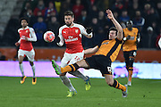 Hull City defender Harry Maguire (12) clears ball away from Olivier Giroud of Arsenal FC (12) during the The FA Cup fifth round match between Hull City and Arsenal at the KC Stadium, Kingston upon Hull, England on 8 March 2016. Photo by Ian Lyall.