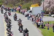 Hurley, New York  - Hundreds of motorcycles led the motorcade escorting the body of  U.S. Army Sgt. Shawn M. Farrell II as people lined  Route 209 on May 7, 2014. Farrell died April 28 when forces attacked his unit with small arms fire in Afghanistan.