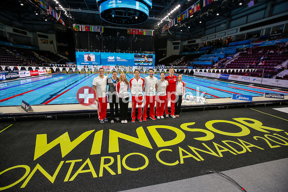 (L-R) Swiss Swimming Team with Paul (Pablo) Kutscher (coach), Liechtenstein's Julia Hassler, Maria Ugolkova, Martin Schweizer, Markus Buck (national high performance director), Nicola Poulsen (Osteopath), Jeremy Desplanches and Martina van Berkel pose for a photo during the 13th Fina World Short Course Swimming Championships held at the WFCU Centre in Windsor, Ontario, Canada, Sunday, Dec. 11, 2016. (Photo by Patrick B. Kraemer / MAGICPBK)