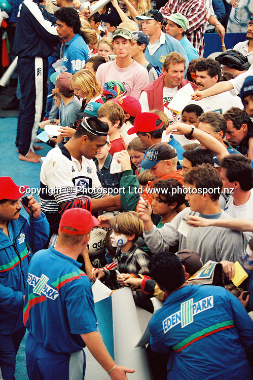 Jonah Lomu signing autographs for fans.<br /> Super 12 Rugby final between the Auckland Blues and Natal Sharks at Eden Park, Auckland, New Zealand on 25 May 1996.<br /> The Blues won the final 45-21.<br /> Copyright photo: www.photosport.nz