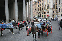 Horse and carraiges outside the Pantheon in Rome Italy in the Piazza Della Rotonda