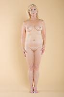 Full length of naked middle-aged woman standing