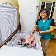 "CAPTION: ""We are working on building our customer base"", says Miss Ha of the Transaction Office of Cooperative Huy Tuong II in Hanoi, as she reaches for some of the pork that's produced by the farmers of the commune (in future, this transaction office will be split from Cooperative Huy Tuong II to become a unit of the Cooperative Union, to be established in 2016). ""Many of our orders are for staff of particular schools and companies, and we also have a website on which people can place orders"", she goes on. They have to target customers with stable incomes, as the price is a little bit higher than other places in order to cover transportation costs. ""Our customers appreciate the quality of our products"", she points out, ""so it works out. We want to continue to help farmers make good quality products, so that the people of Hanoi can have access to high quality produce while supporting local producers"". LOCATION: Transaction Office, Cooperative Huy Tuong II, Hanoi, Vietnam. INDIVIDUAL(S) PHOTOGRAPHED: Tran Ha."