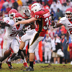 Sep 26, 2009; College Park, MD, USA; Maryland punter Ted Townsley (37) barely kicks the ball away after dropping the snap in his own end zone during the second half of Rutgers' 34-13 victory over Maryland in NCAA college football at Byrd Stadium.