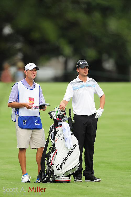 Sean O'Hair and his caddie during the third round of the Wells Fargo Championship at the Quail Hollow Club on May 5, 2012 in Charlotte, N.C. ..©2012 Scott A. Miller.