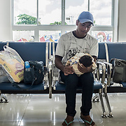 Jayane (17), her daughter Nathally (6 months) and her husband Daniel (20) waiting for their turn  at the rehabilitation center FAV (Fundação Atilio Valente) in Recife, Pernambuco. Jayane and her husband Daniel are indigenous people of the tribe Xukuru do Ororubá from the interior of Pernambuco state, 350 km from Recife. They don't have a house in Recife so they have to travel more than three hours in order to come to the rehabilitation center every week