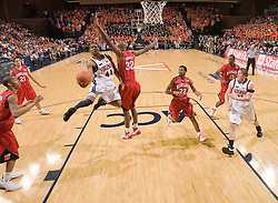 Virginia guard Sean Singletary (44) beats Maryland forward Jerome Burney (32) to the basket.  The Virginia Cavaliers defeated the Maryland Terrapins 91-76 at the University of Virginia's John Paul Jones Arena  in Charlottesville, VA on March 9, 2008.