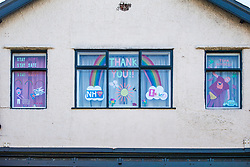 © Licensed to London News Pictures. 06/04/2020. Harrogate UK. Messages in a window opposite Harrogate Convention Centre as work continues this morning at the centre in Yorkshire that is being turned into a Nightingale Hospital due to the coronavirus outbreak. Photo credit: Andrew McCaren/LNP