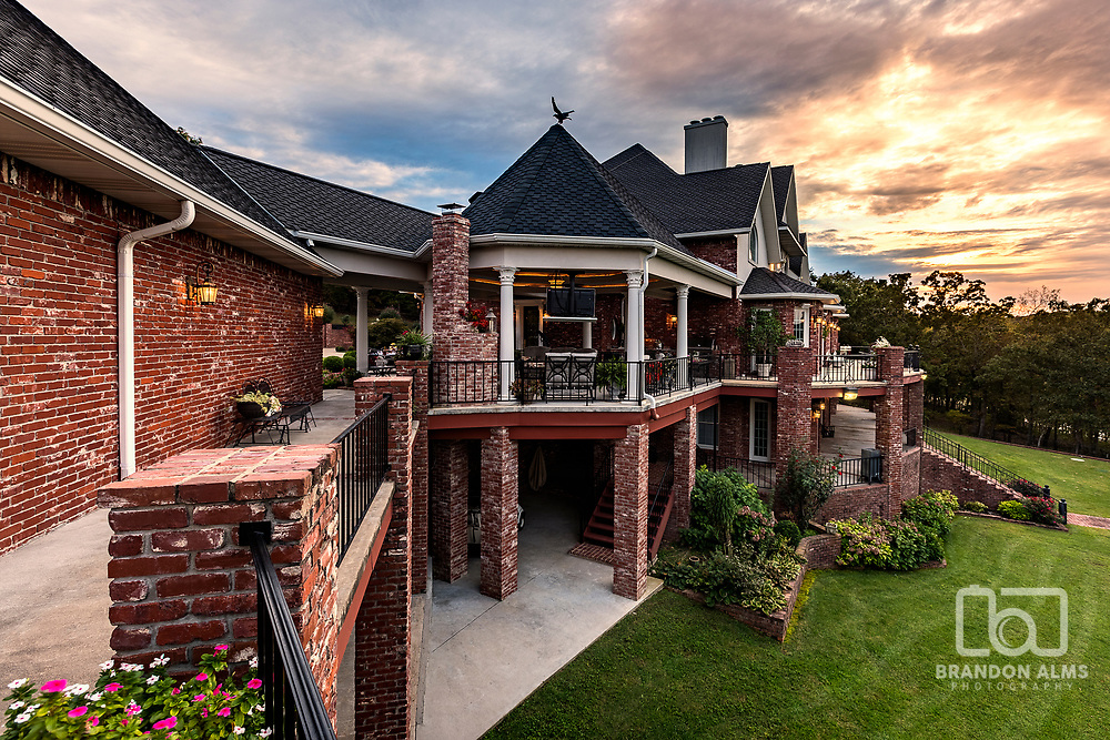 Huge lakefront mansion at sunset. Photography by Brandon Alms Photography