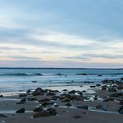 Rocks in outgoing tide, Plum Island, Newbury, MA. Cape Ann on the horizon.