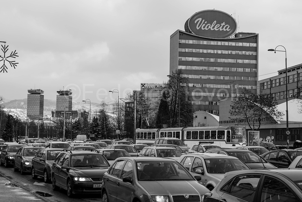 Today Sniper Allee is an anonymous avenue that goes to the suburbs .Unthinkable this kind of traffic during the siege , but today private cars are in great quantities also in Sarajevo