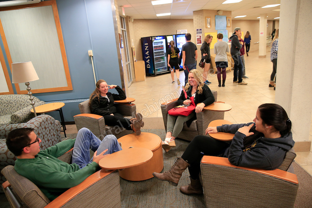 Students relax and talk in the Fabiano/Woldt/Emmons lobby. Photo by Steve Jessmore/Central Michigan University
