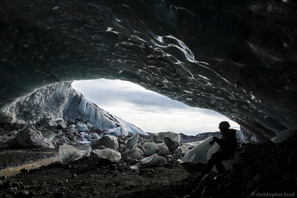Photographers in an Ice Cave in Virkisjökull outlet glacier, Southeast Iceland.
