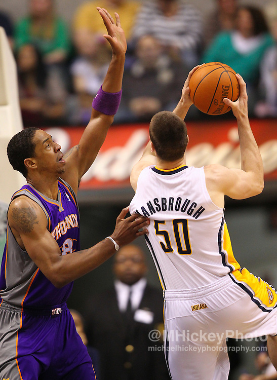 Feb. 27, 2011; Indianapolis, IN, USA; Phoenix Suns center Channing Frye (8) defends against Indiana Pacers forward Tyler Hansbrough (50) at Conseco Fieldhouse. Phoenix defeated Indiana 110-108. Mandatory credit: Michael Hickey-US PRESSWIRE