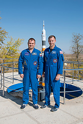 Expedition 57 prime crew members Alexey Ovchinin of Roscosmos, left, and Nick Hague of NASA, right, pose for pictures in front of a model of a Soyuz rocket, Wednesday, Oct. 3, 2018 at the Cosmonaut Hotel crew quarters in Baikonur, Kazakhstan. Ovchinin and Hague are scheduled to launch on Oct. 11 onboard the Soyuz MS-10 spacecraft from the Baikonur Cosmodrome in Kazakhstan for a six-month mission on the International Space Station. Photo Credit: (NASA/Victor Zelentsov)