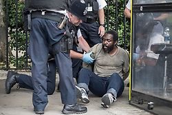 © Licensed to London News Pictures. 22/06/2017. London, UK. Police search a man on the ground they are detaining who earlier was tasered near an entrance to Parliament. Photo credit: Peter Macdiarmid/LNP