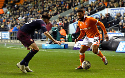 Arsenal's Carl Jenkinson (left) and Blackpool's Liam Feeney battle for the ball during the Emirates FA Cup, third round match at Bloomfield Road, Blackpool.