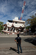 Padang, Western Sumatra, Indonesia, 7th October 2009:?A heavily tilted building remains standing on Dobi Street in Padang following a devastating earthquake in Western Sumatra that claimed the lives of an estimated 2000 people.?Photo: Joseph Feil