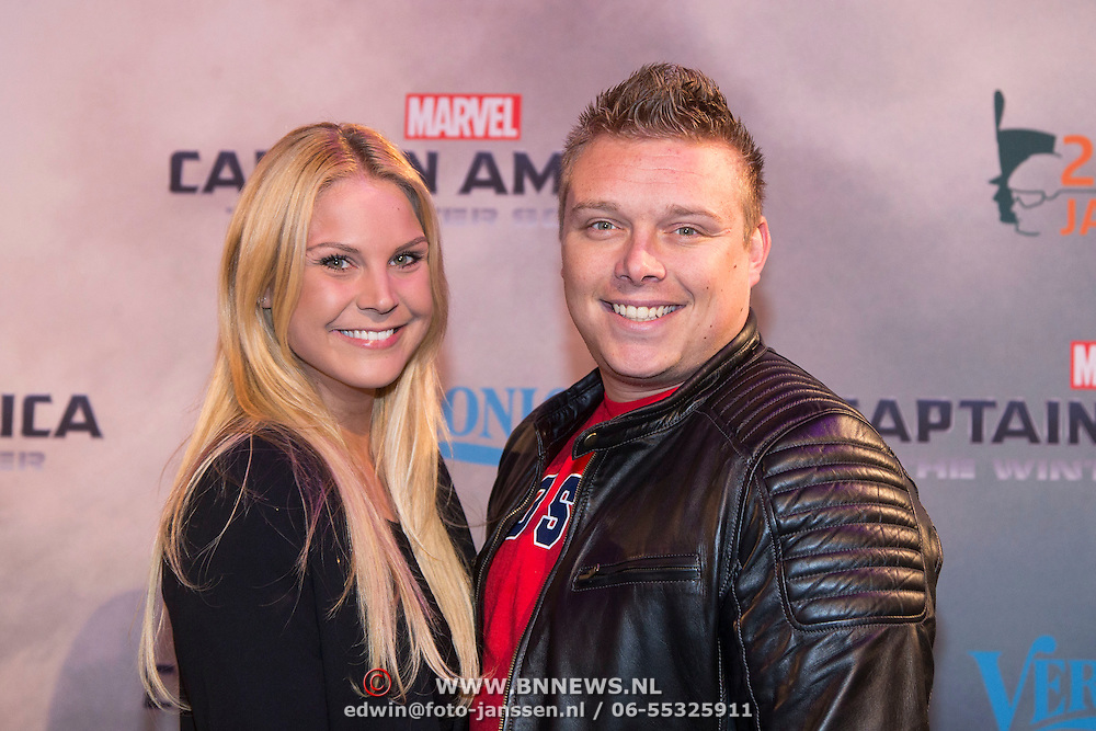 NLD/Amsterdam//20140326 - Filmpremiere Captain America The Winter Soldier, Tony Wyczynski en partner Yidiz Siskens
