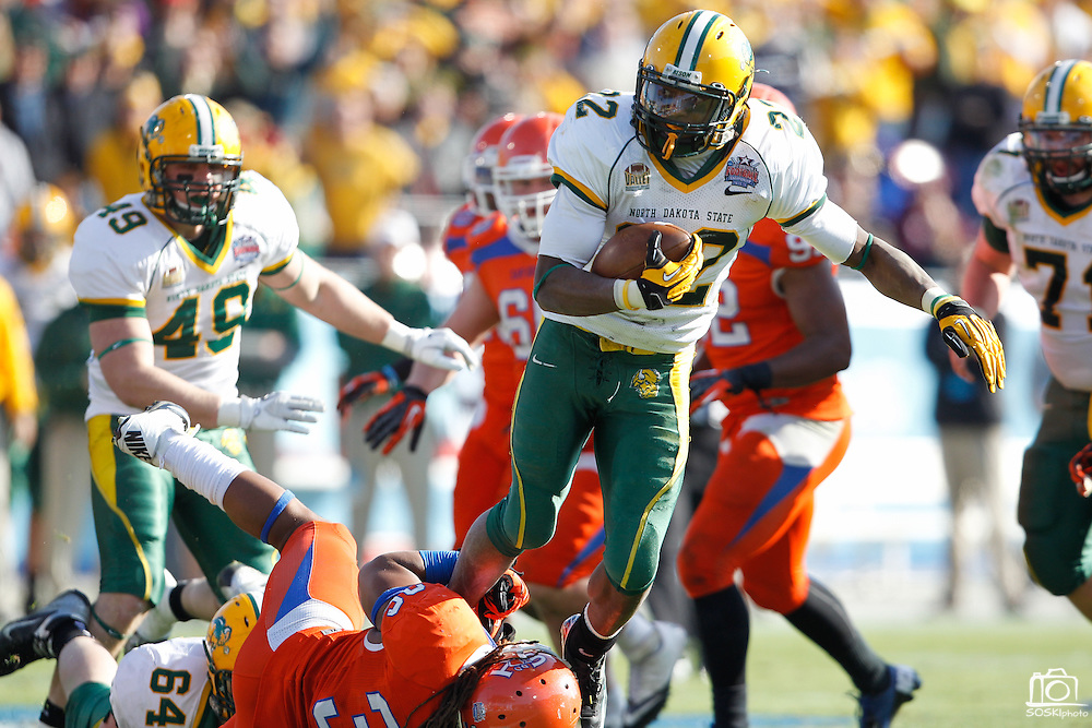 North Dakota State Bison running back Sam Ojuri (22) is tackled by Sam Houston State Bearkats linebacker Darius Taylor (36) during the FCS title game at FC Dallas Stadium in Frisco, Texas, on January 5, 2013.  (Stan Olszewski/The Dallas Morning News)