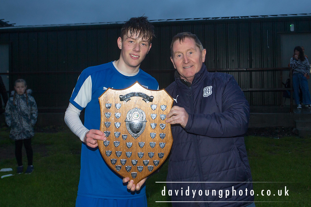St.John's captain Ross McNaughton is presented with the trophy by John Burke of Dundee FC Supporters Association - St.John's v. Grove - Arab Trust DSA Senior Champions League Final at East Craigie