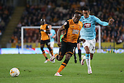 Hull City midfielder Moses Odubajo (2)  shields the ball from Derby County midfielder Thomas Ince (23)  during the Sky Bet Championship play-off 2nd leg match between Hull City and Derby County at the KC Stadium, Kingston upon Hull, England on 17 May 2016. Photo by Simon Davies.