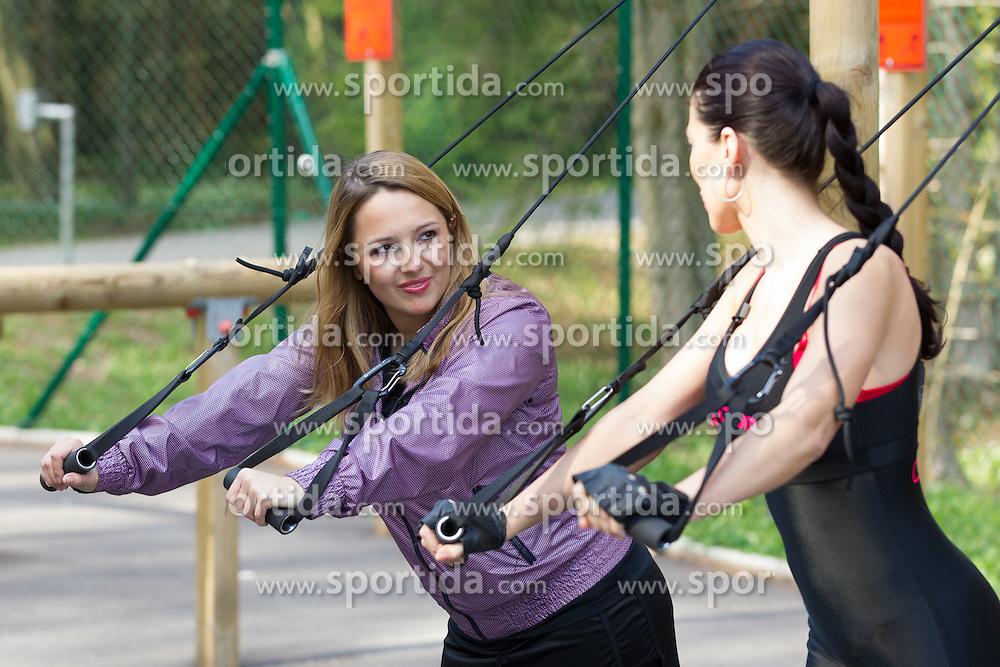 Katja Klavora, journalist of Planet Siol.net and Iris Mulej, Miss Slovenia 2006, doing exercises at Castle Brdo, on April 10, 2012, in Kokrica at Kranj, Slovenia (Photo by Crt Slavec)