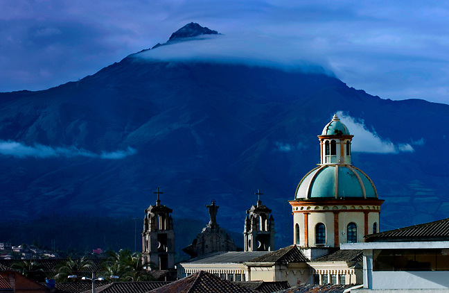 Cotacachi Volcano provides a dramatic backdrop for the colonial dome of the Church of the Jordan, Otavalo, Ecuador.