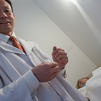 Dr Yu Funian performs an acupuncture treatment in Budapest, Hungary on December 21, 2012. ATTILA VOLGYI