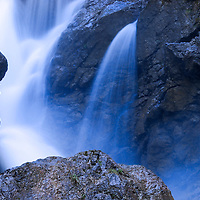 Close up of part of a waterfall, slow shutter speed creating silky water.
