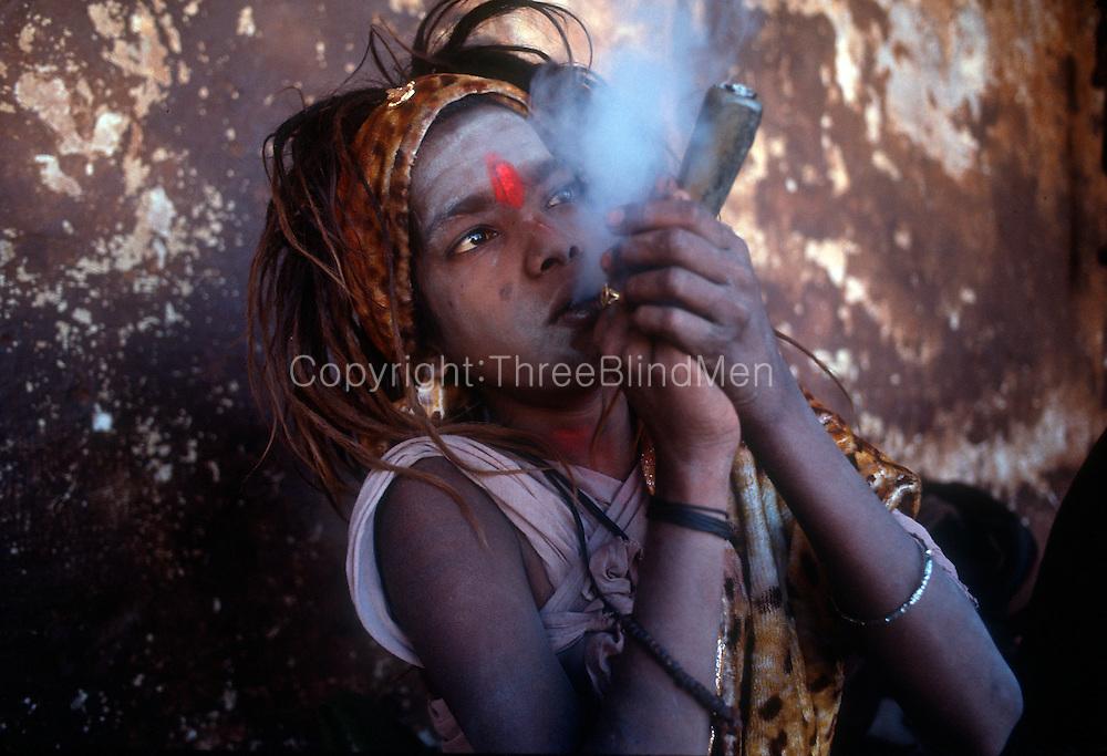 Nepal. Kathmandu. Young swami at Pashupatinath smoking hashish and tobacco. Kathmandu valley..