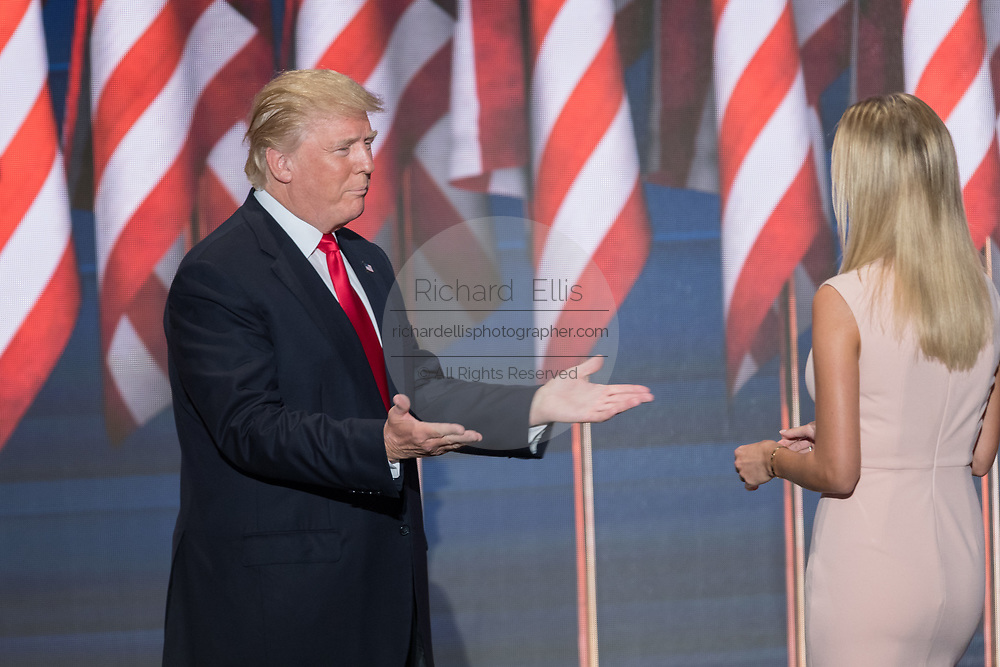 GOP Presidential candidate Donald Trump reaches out to embrace his daughter Ivanka Trump as he enters the stage to accept the party nomination for president on the final day of the Republican National Convention July 21, 2016 in Cleveland, Ohio.