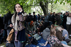 Hyde Park, London, 20/04/2014<br /> A girls smokes a spliff whilst people shelter from rain during a pro cannabis rally held by group 420 at Hyde Park, central London. <br /> Photo: Anna Branthwaite/LNP