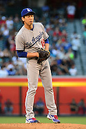 PHOENIX, AZ - JUNE 14:  Kenta Maeda #18 of the Los Angeles Dodgers looks for a sign from the catcher in the first inning of the game against the Arizona Diamondbacks at Chase Field on June 14, 2016 in Phoenix, Arizona. Los Angeles Dodgers won 7-4.  (Photo by Jennifer Stewart/Getty Images)