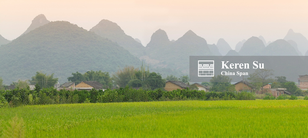 Village, farmland and karst hills, Yangshuo, Guangxi, China