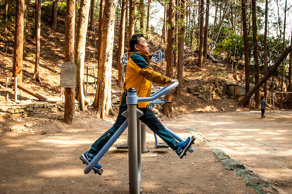 A man uses outdoor exercise equipment at Busan Grand Children's Park in Busan, South Korea.