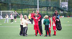 NEWPORT, WALES - Wednesday, July 4, 2012: Wales football coach Osain Williams coaches children on the new 3G pitch at the National Development Centre at the Newport International Sports Village. (Pic by David Rawcliffe/Propaganda)