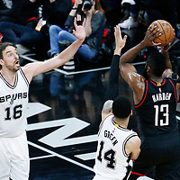 03 May 2017: Houston Rockets guard James Harden (13) passes the ball over San Antonio Spurs guard Danny Green (14) and San Antonio Spurs center Pau Gasol (16) during the San Antonio Spurs 121-96 victory over the Houston Rockets, in game 2 of the Western Conference Semi Finals, at the AT&T Center, San Antonio, Texas, USA.