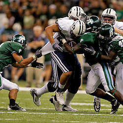 Sep 12, 2009; New Orleans, LA, USA; Tulane Green Wave defenders Alex Wacha (8) and Travis Burks (6) and Shakiel Smith (49) combine to tackle BYU Cougars running back Harvey Unga (45) during the first half at the Louisiana Superdome.  BYU defeated Tulane 54-3. Mandatory Credit: Derick E. Hingle-US PRESSWIRE