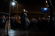 U.S. Democratic presidential candidate Hillary Clinton points at a member of the audience as she takes questions at a campaign event at Clinton Middle School in Clinton, Iowa November 22, 2015.