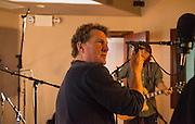 Eddie Ashworth adjusts the position of a microphone  during a recording session with the band Controlled Folly.