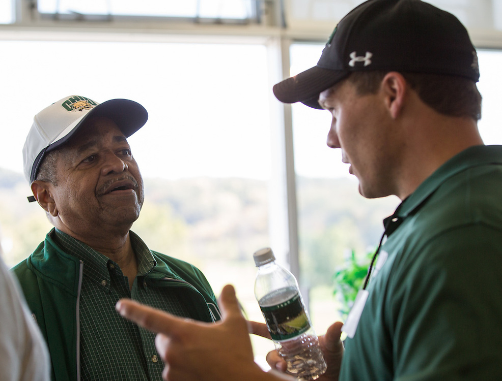 Ohio University President Roderick McDavis, left, talks with Michael Logue, a Combat Veteran and pioneering military activist and a recipient of the Charles J. and Claire O. Ping Recent Graduate Award, right, during the Ohio University Homecoming game on October 10, 2015 at Peden Stadium. Photo by Emily Matthews