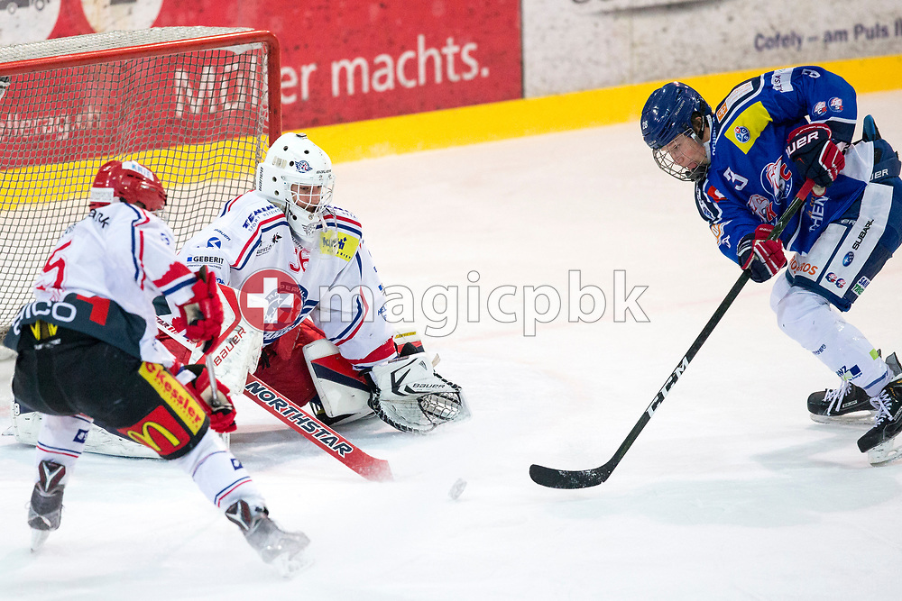 ZSC Lions forward Nils Pfister (R), Rapperswil-Jona Lakers goaltender Beat Trudel (C) and defenseman Janis Manser (L) battle for possession during the fourth Elite B Playoff Final ice hockey game between ZSC Lions and Rapperswil-Jona Lakers in Duebendorf, Switzerland, Friday, Mar. 17, 2017. (Photo by Patrick B. Kraemer / MAGICPBK)