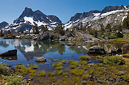 Banner Peak is reflected in a small pool above Thousand Island Lake, Ansel Adams Wilderness