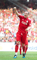 KUALA LUMPUR, MALAYSIA - Saturday, July 16, 2011: Liverpool's new signing Charlie Adam celebrates scoring the first goal from the penalty spot against a Malaysia XI at the National Stadium Bukit Jalil in Kuala Lumpur on day six of the club's Asia Tour. (Photo by David Rawcliffe/Propaganda)