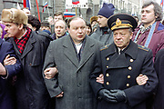 Former acting Russian Prime Minister Yegor Gaidar, center,  alongside his father Admiral Timur Gaidar, right, lead a mass demonstration in support of President Boris Yeltsin March 28, 1993 in Moscow, Russia. Thousands marched through central Moscow ending in Red Square where Yeltsin addressed the crowd.