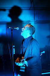 Coldplay lead singer Chris Martin, plays guitar, on stage at a concert at the Queens Hall, Edinburgh, on 19/6/2002.