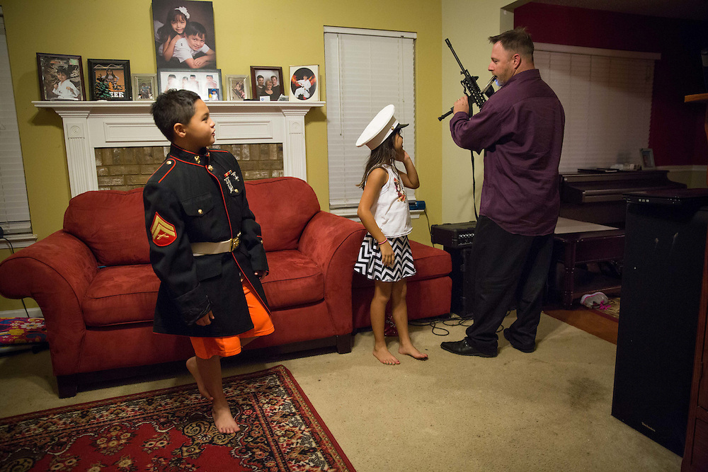 Photos of Chris Hill (A.K.A. Blood Agent) and his family at their home near McDonough, Ga. on Thursday, Oct. 8, 2015. Hill is one of the founding members of Georgia Security Force III% militia. His son, Ashton, is 10, and his daughter, Kayla, is 8. Wife is Gwen. Been together about 15 years. Hill has been a bankruptcy paralegal for about 12 years. Photo by Kevin D. Liles/kevindliles.com